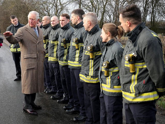 Prince Charles wearing the coat made for him in the 1970s by  Anderson & Sheppard,  during a visit in December last year to Fishlake, in South Yorkshire, which was hit by floods. Nigel Roddis/PA Wire