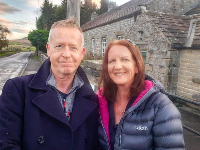 Martin and Sue Stephenson outside Arkengarthdale C of E Primary School