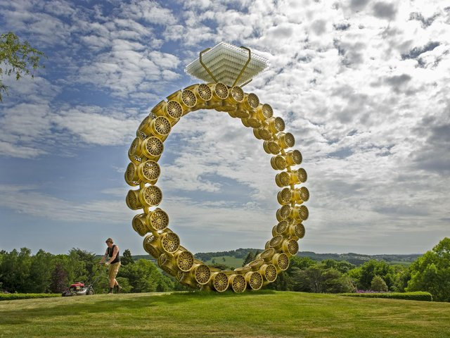Operations worker Will Poppleton mows the grass around Portuguese artist Joana Vasconcelos' Solitaire at the Yorkshire Sculpture Park. Picture: Tony Johnson.