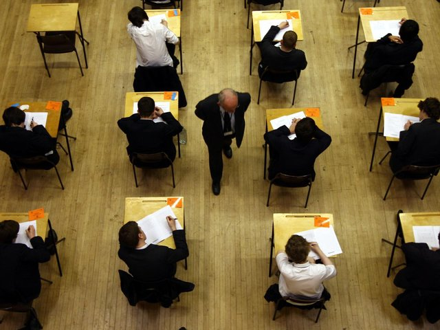 File photo of a general view of pupils sitting an exam. Most A-level and GCSE exams in England will be delayed by three weeks next year due to the pandemic, Education Secretary Gavin Williamson has confirmed. Photo: PA