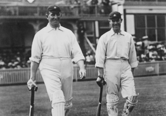 Striding out: Australian cricketers Warwick Armstrong (1879 - 1947), left, and Victor Trumper (1877 - 1915) going out to bat in the First Test against England at Birmingham, 27th  May 1909. (Photo by Topical Press Agency/Hulton Archive/Getty Images)