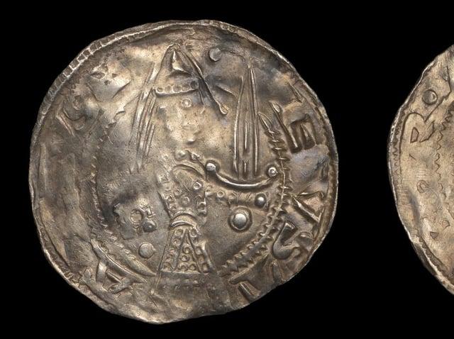 The 12-century coin.