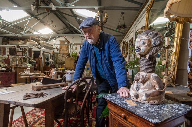 Stephen Hazell, owner of The French House, surrounded by French Antiques in his York warehouse.