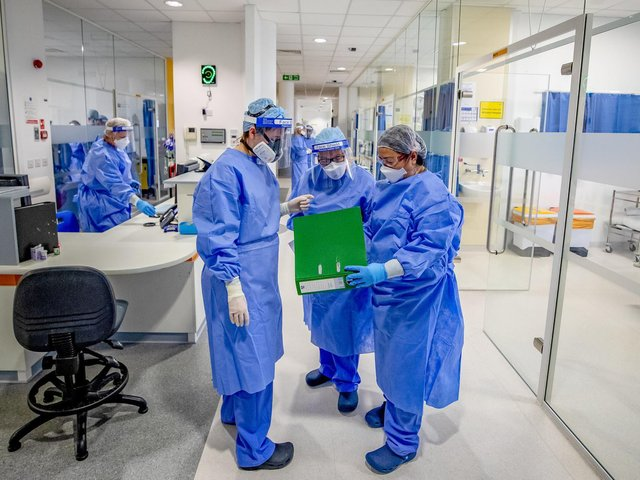 File photo dated 20/10/2020 of health workers wearing full personal protective equipment (PPE). Ministers set aside normal standards of transparency as they scrambled to secure GBP 18 billion of supplies and services in response to the coronavirus crisis, the public spending watchdog has concluded. Photo: PA