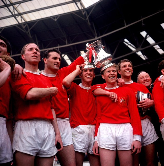 Manchester United players (left to right) Bobby Charlton, Noel Cantwell, Pat Crerand, Albert Quixall and David Herd celebrate with the FA Cup in 1963.