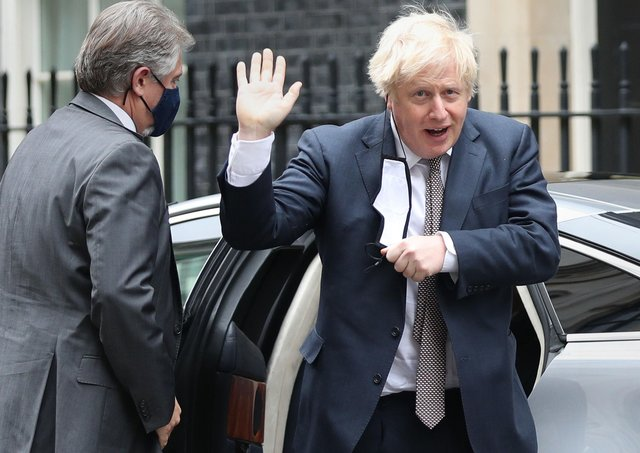 Boris Johnson arrives back in Downing Street following his first public appearance after two weeks in self-isolation.