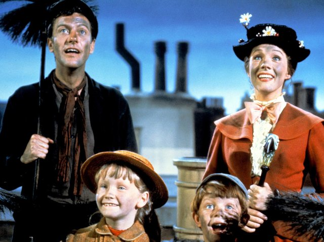 Dick Van Dyke as Bert, Julie Andrews as Mary Poppins, Karen Dotrice as Jane Banks and Matthew Garber (1956 - 1977) as Michael Banks in the Disney musical Mary Poppins, from 1964. ( Silver Screen Collection/Hulton Archive/Getty Images).