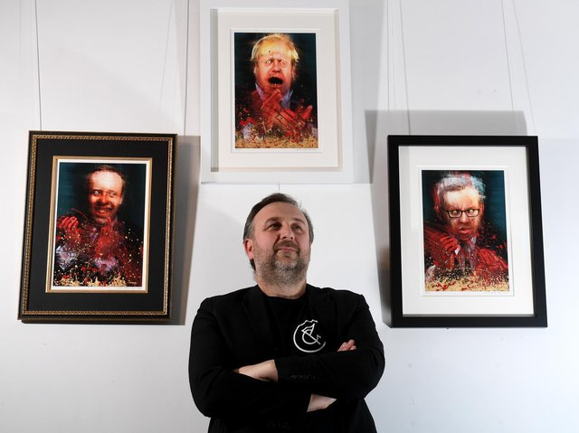 Craig Humble in front of the artwork by WeFail