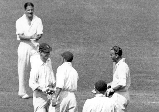 Well done: Len Hutton is congratulated by Don Bradman. Pictures: Getty Images