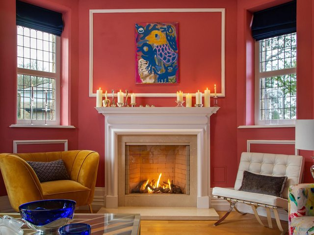 One of the sitting rooms with the mantlepiece decked with candles