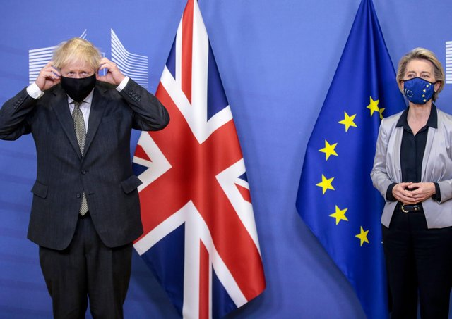 Britain's Prime Minister Boris Johnson  is welcomed by European Commission President Ursula von der Leyen in the Berlaymont building at the EU headquarters in Brussels.