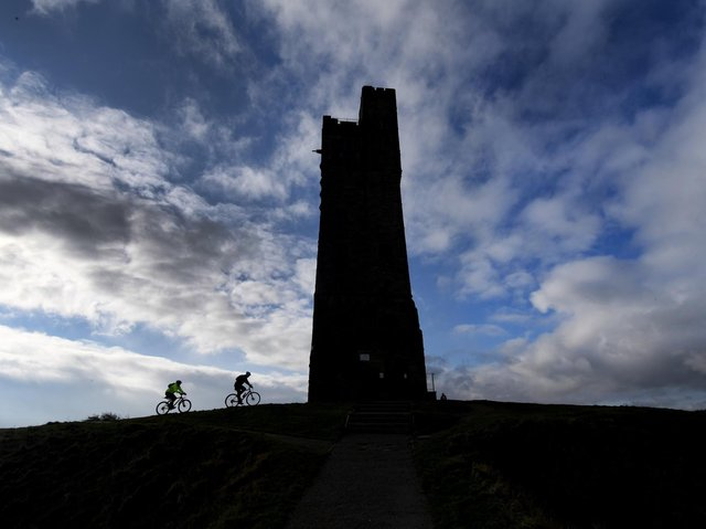 Cyclists are pictured riding up to Castle Hill, Huddersfield. Technical details: Nikon D5, 12-24mm lens, exposure 320th sec at f11, iso 200. Picture: Simon Hulme