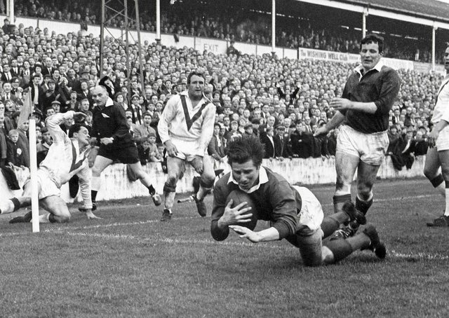Double delight: Wakefield Trinity centre Ian Brooke scores one of his two tries in the 1967 Rugby League Championship final replay victory over St Helens at Station Road, Swinton.
