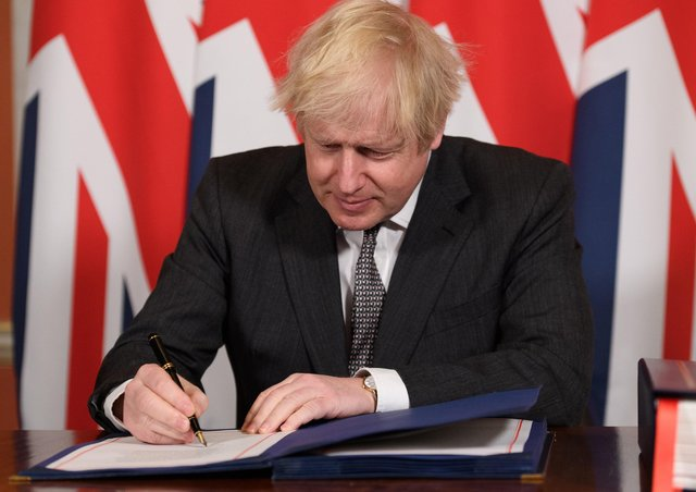 Prime Minister Boris Johnson signs the EU-UK Trade and Cooperation Agreement at 10 Downing Street, Westminster, paving the way for Brexit to finally happen this New Year. Photo: PA/Leon Neal