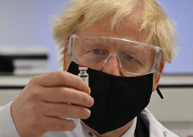 Prime Minister Boris Johnson holds a vial of the Oxford/AstraZeneca vaccine. Picture: Paul Ellis/PA Wire