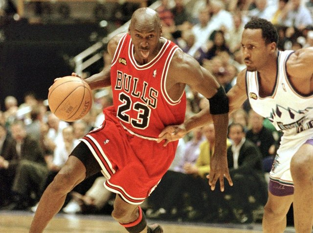 Michael Jordan (left) in  action with the Chicago Bulls in 1998. (AFP via Getty Images).