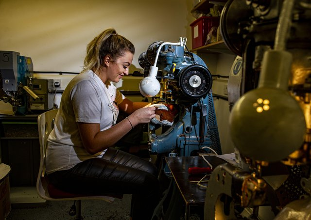 Kamila Kluska, Goral production manager and great granddaughter of the founder, inserts the eyelets for a pair of men's hybrid shoes at Sheffield-based family footwear company Goral. Picture by Tony Johnson.