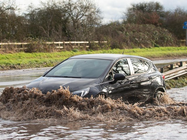 Motorists make their way through floodwater on Derby Road in Hathern, Leicestershire, as Storm Christoph hits