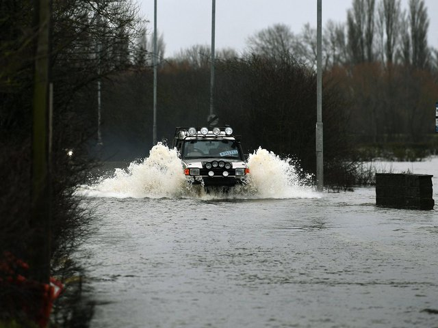 Police have urged people not to ignore road closures after drivers got stranded in the floodwater.