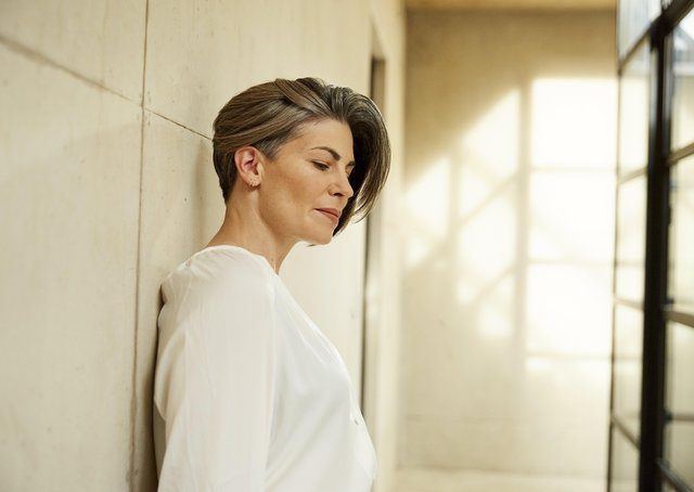 Sabrina Golonka, a university lecturer from Leeds, one of the campaign images from the Wella shoot, showing how she can achieve different tones depending on where she parts her hair.