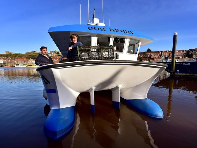 Whitby has a new lobster fishing boat ' Our Henry' Business partners Terry Pearson and Luke Russell on the vessel in Whitby  Picture: Richard Ponter