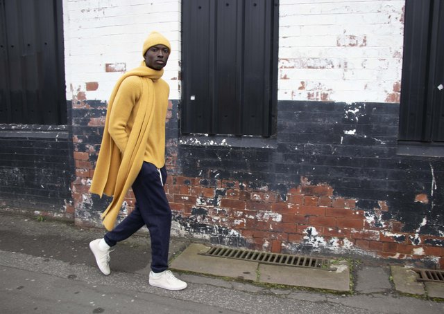 Shot on location in Holbeck, Leeds: Recycled cashmere beanie hat, £45, and scarf, £95, and ribbed crew sweater in amber, £165; organic cotton track pants, £70. All at cutandpin.com. SHOOT CREDITS: Tara Sagar Photography; Model – Obed Wilson @ Boss models; Location – Holbeck, Leeds; studio images – Box Photographic; Styling – Martin Parker.