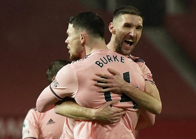 Sheffield United's Oliver Burke (left) celebrates with Chris Basham after scoring the winning goal at Manchester United (Picture: PA)