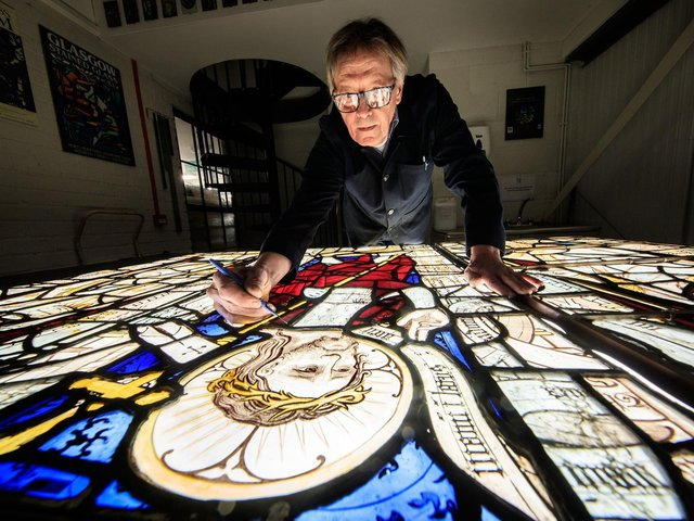 Conservator Keith Barley MBE works on large stained glass windows from All Saints North Street Church at Barley Studio in York. Barley Studio will conserve twelve medieval windows over the next two years. Image: Danny Lawson/PA Wire