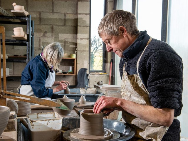 Lee Cartledge and his mother Kathy at work in their pottery studio