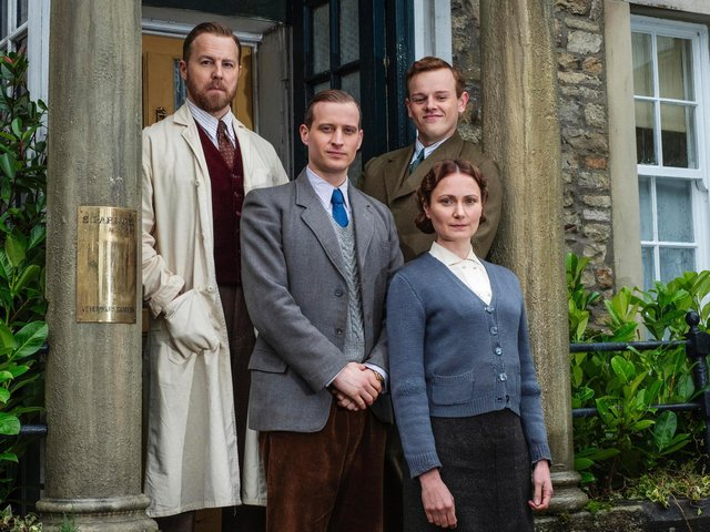 Siegfried and Tristan Farnon with James Herriot and Mrs Hall outside Skeldale House.