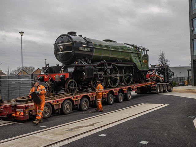 The Green Arrow locomotive arrives in Doncaster after being transported by road from the National Railway Museum's sister attraction, Locomotive in Shildon in County Durham. The famous engine, which was built in Doncaster in 1932, will go on show at a new rail heritage centre, the Danum Gallery, Library and Museum in the South Yorkshire town. (Picture: Charlotte Graham.)