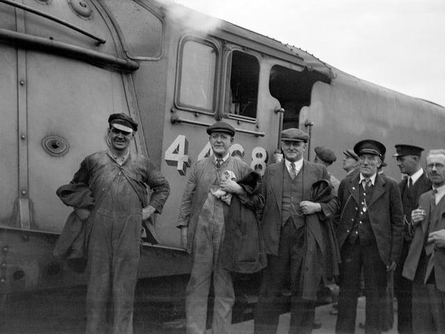 Mallard, July 3, 1938, from left, fireman Thomas Bray, driver Joe Duddington, Sam Jenkins from LNER and guard Henry Croucher. (Picture credit: National Railway Museum/SSPL).