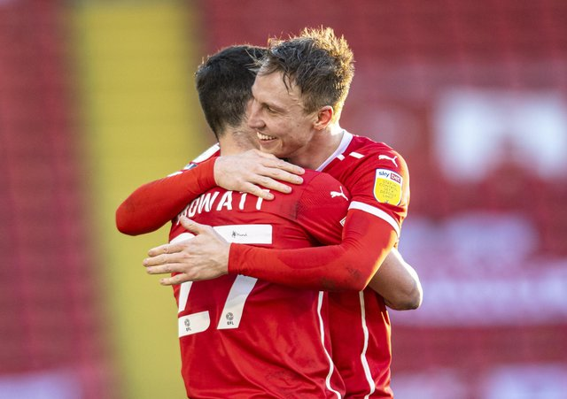 Victory: Cauley Woodrow celebrates the win with Alex Mowatt at the end of the game. Pictures: Tony Johnson
