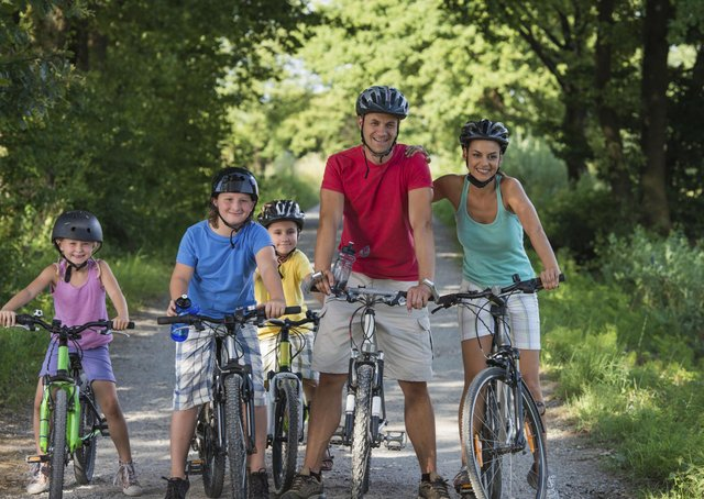 How can safe cycling be encouraged and promoted?