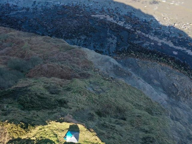 Emergency service personnel found the family in a tent around six feet from the edge of a sheer precipice.