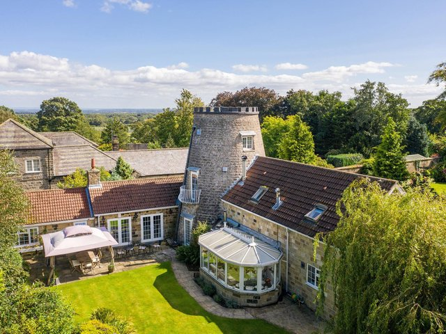 The converted windmill and its extensions add up to a large family home