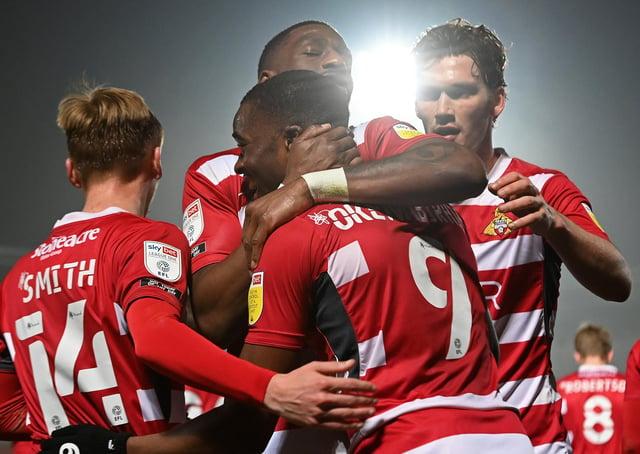 Doncaster's players celebrate Fejiri Okenabirhie's goal. Picture: Andrew Roe/AHPIX LTD