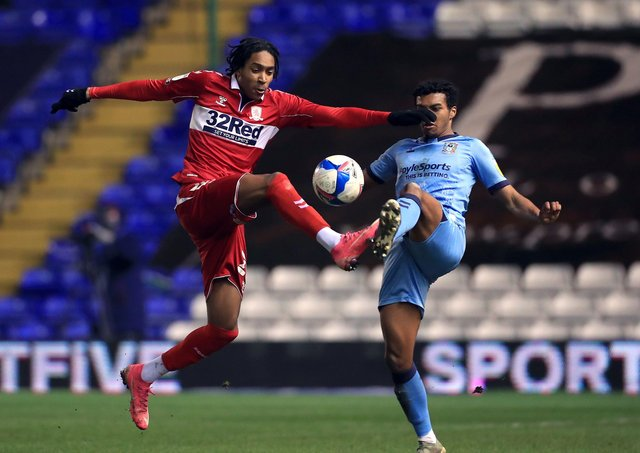 Middlesbrough's Djed Spence (left) and Coventry City's Sam McCallum battle for the ball on Tuesday night. Picture: Mike Egerton/PA