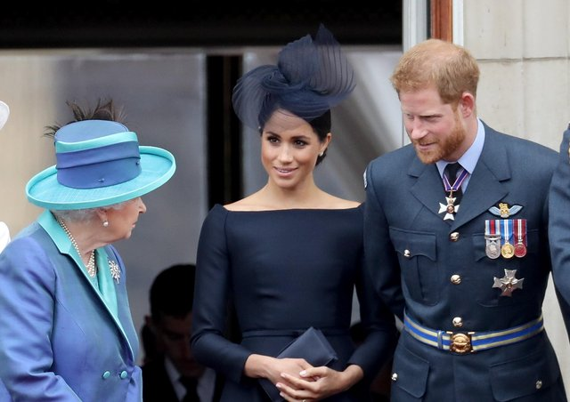 The Queen with the Duke and Duchess of Sussex on the Buckingham Palace balcony to mark the centanry of the RAF in 2018.
