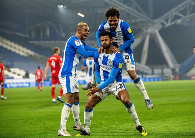 Fraizer Campbell celebrates scoring Huddersfield's opening goal with Juninho Bacuna and Duane Holmes.  Picture Bruce Rollinson