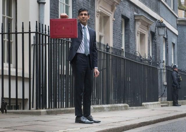 Chancellor Rishi Sunak outside 11 Downing Street on Budget day.