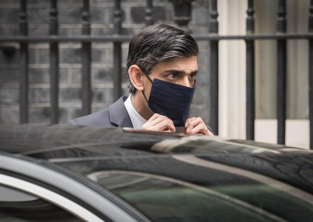 Chancellor Rishi Sunak leaves Downing Street to deliver his Budget.