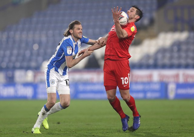 BACK IN THE GAME: Huddersfield Town's Richard Stearman battles with Birmingham City's Lukas Jutkiewicz at John Smith's Stadium on Tuesday night. Picture: George Wood/Getty Images.