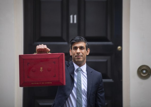 Chancellor Rishi Sunak leaves 11 Downing Street to deliver his Budget,