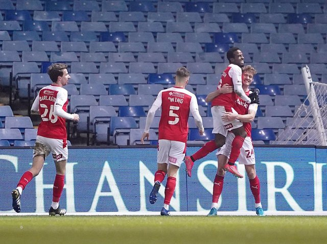 OPENER: Micharel Smith (far right) celebrates the opening goal