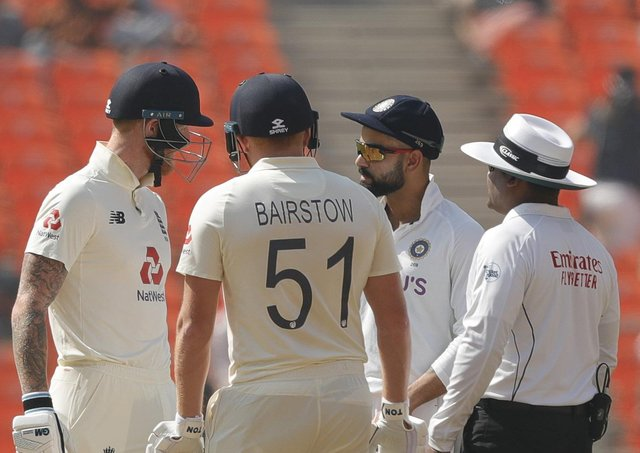 FLASHPOINT: England's Ben Stokes, left, and India captain Virat Kohli, second right, exchange words in the middle during day one in Ahmedabad. Picture: Saikat Das / Sportzpics for BCCI (via ECB).