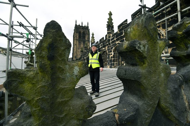The Rev Canon Hilary Barber on the Halifax Minster roof. Picture  Jonathan Gawthorpe