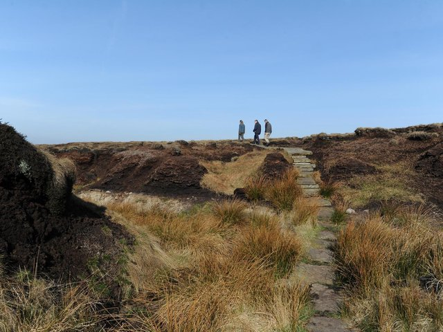 An area of peat erosion and flagstone paving on Marsden Moor, which is protected by National Trust