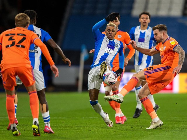 Huddersfield Town's Juninho Bacuna sticks a foot in against Cardiff City. Picture: BRUCE ROLLINSON.