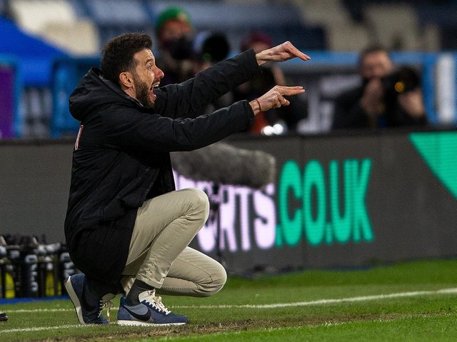 Huddersfield Town head coach Carlos Corberan makes his point in Friday night's home game with Cardiff City. Picture: Bruce Rollinson.